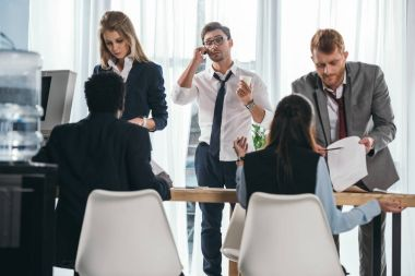 group of business partners having conversation at office