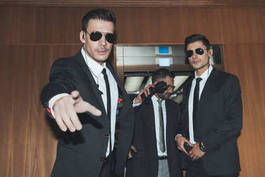 bodyguards stopping paparazzi when celebrity going out from elevator