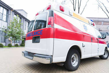 ambulance white and red car on street