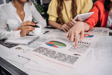 cropped shot of businesswomen doing paperwork