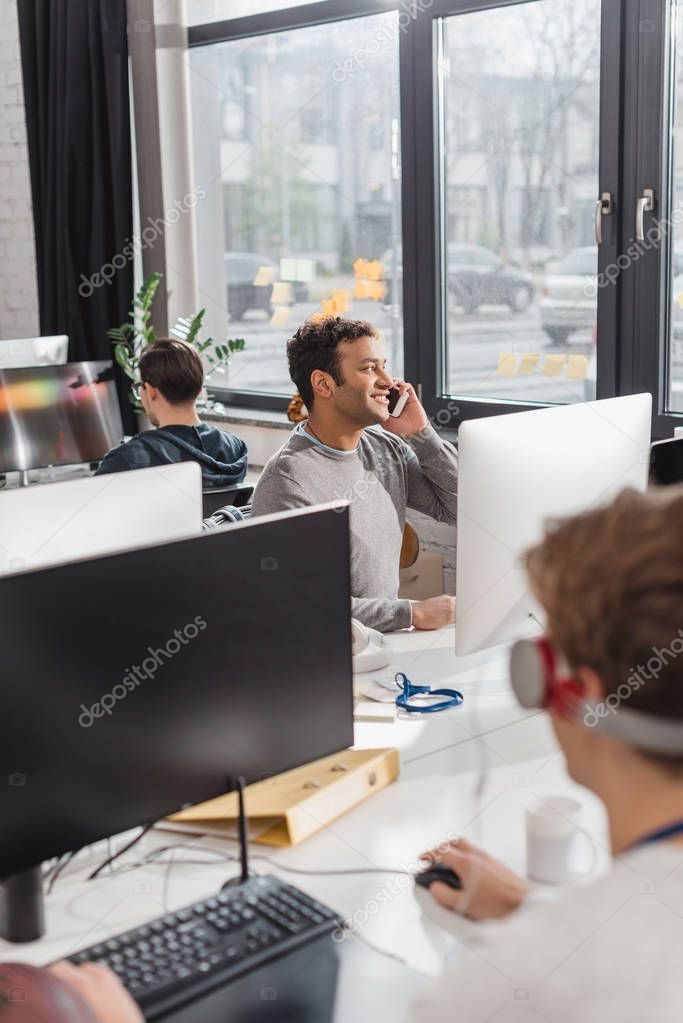 colleagues working together at modern office