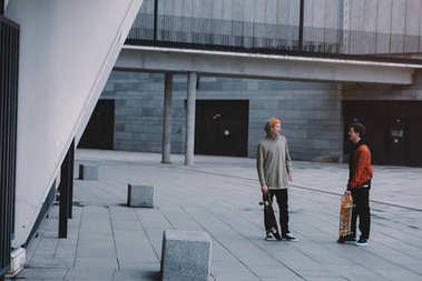 Skateboarders talking after ride in modern urban location stock vector