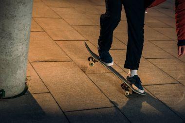 Cropped shot of skateboarder preforming balance trick stock vector