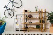 Photo bike on wall and shelves with stuff at home