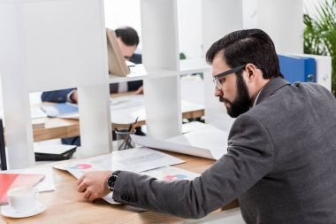 businessman working with documents at table in office