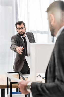businessmen talking about documents in office