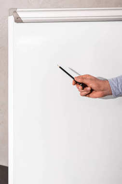 cropped image of businessman showing something at flipchart