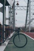vintage bike on pedestrian bridge on cloudy day
