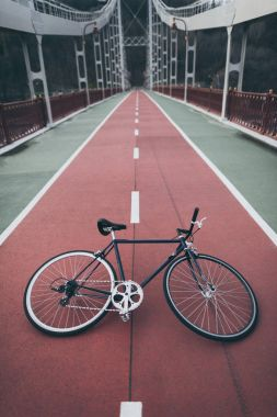 Vintage bike on pedestrian bridge stock vector