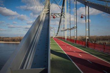 Empty pedestrian bridge on sunny autumn day stock vector