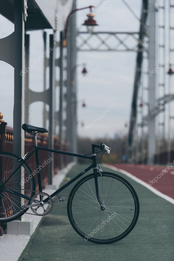 vintage bike on pedestrian bridge on cloudy day
