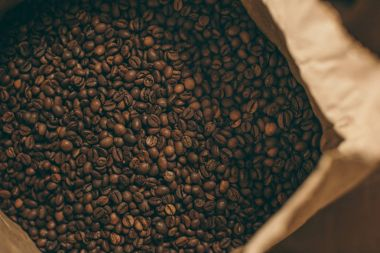 close up view of coffee beans in paper bag
