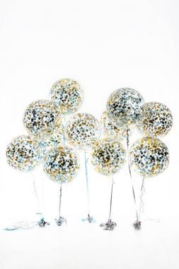 big balloons with golden and blue confetti and stars, isolated on white