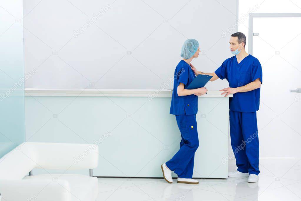 two surgeons discussing diagnosis in hospital