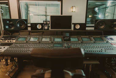view of sound producing equipment at recording studio