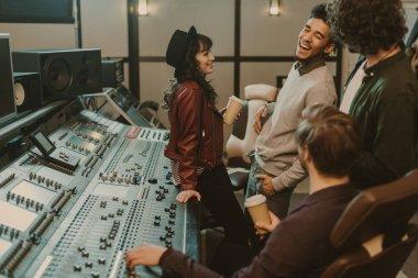 Music band having fun at sound recording studio stock vector