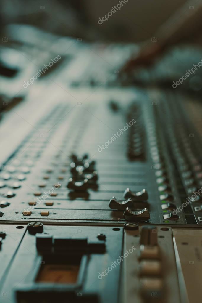 close-up shot of analog graphic equalizer at recording studio
