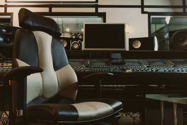Armchair in front of graphic equalizer at recording studio stock vector