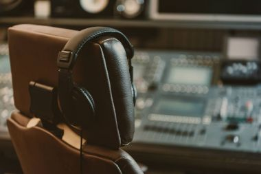 headphones hanging on armchair at recording studio