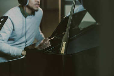 cropped shot of african american man playing piano