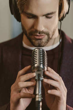 close-up portrait of handsome young singer performing song