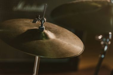 close-up shot of drum cymbal under spotlight on stage