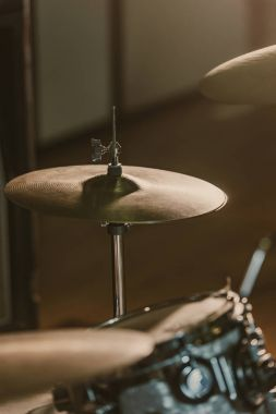 close-up shot of drum cymbals under spotlight on stage