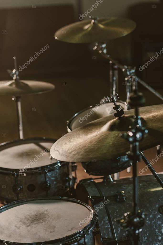 close-up shot of drum set under spotlight on stage