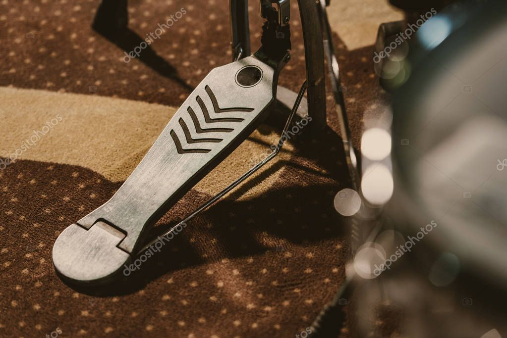 close-up shot of drum pedal on carpet