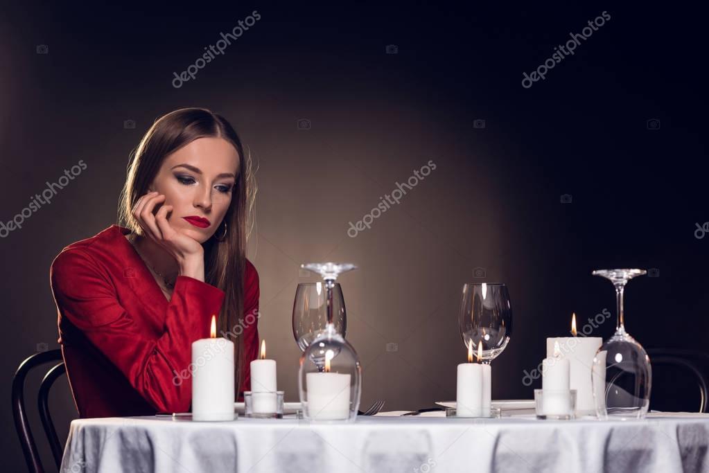 alone sad beautiful woman waiting for romantic date in restaurant