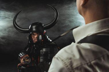 Angry samurai with katana ready to kill modern man stock vector