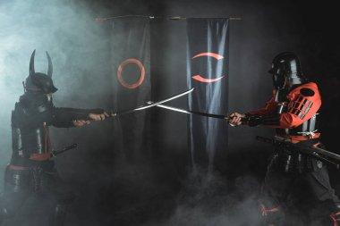Samurai warriors crossing katana swords in front of clan symbols stock vector
