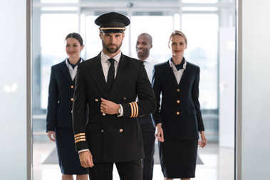 Pilot with stewardesses
