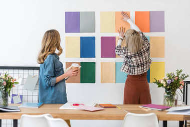 fashionable magazine editors working with color palette in modern office