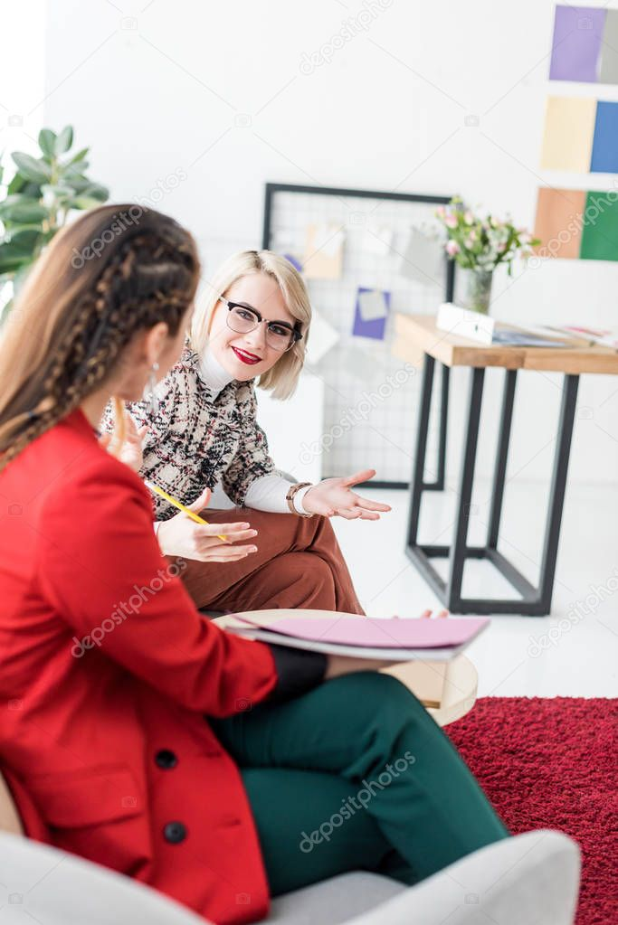 fashionable magazine editors working in modern office