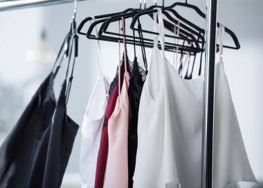close-up shot of various dresses hanging on rack