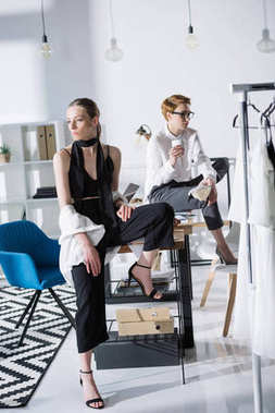young fashion designers sitting on work desk at office