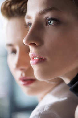 close-up portrait of young women looking away