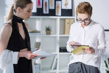 confident young fashion designers working together at office