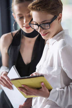 young businesswomen using digital tablet together