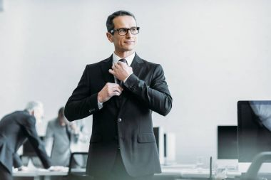 selective focus of businessman in eyeglasses in office