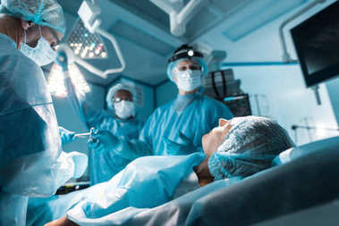 patient lying on operating table in surgery room
