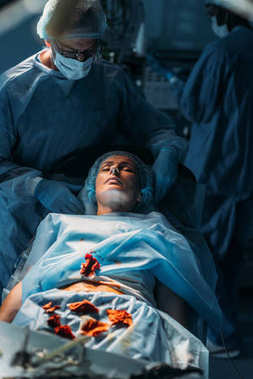 female patient during surgery in operating room