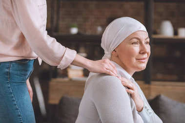 cropped shot of woman supporting sick mature mother in kerchief