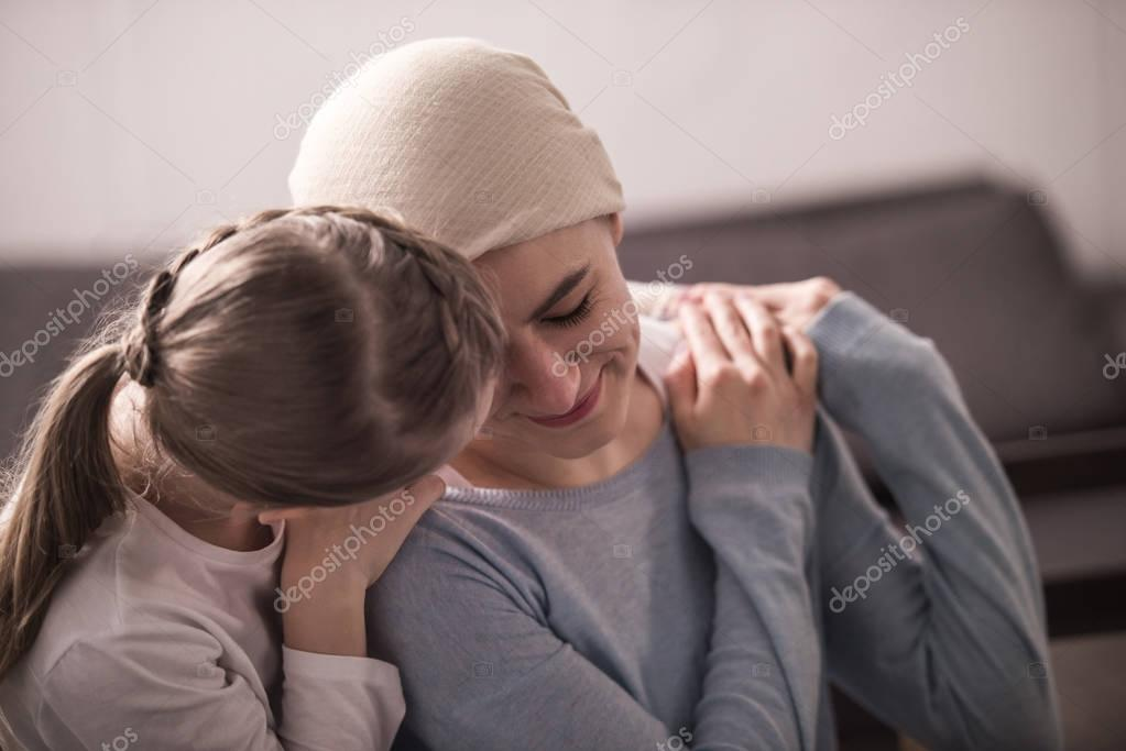 Child hugging and supporting sick mother in kerchief stock vector