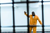 Photo african american prisoner screaming in prison cell