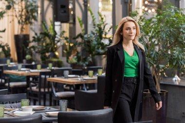 Portrait of beautiful woman walking in restaurant stock vector