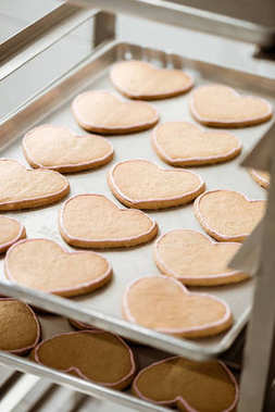 close-up shot of tasty cookies in shape of heart on tray