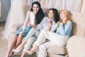 Fotografie Happy young women taking selfie in wedding salon