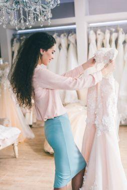 Brunette bride during dress fitting in wedding salon